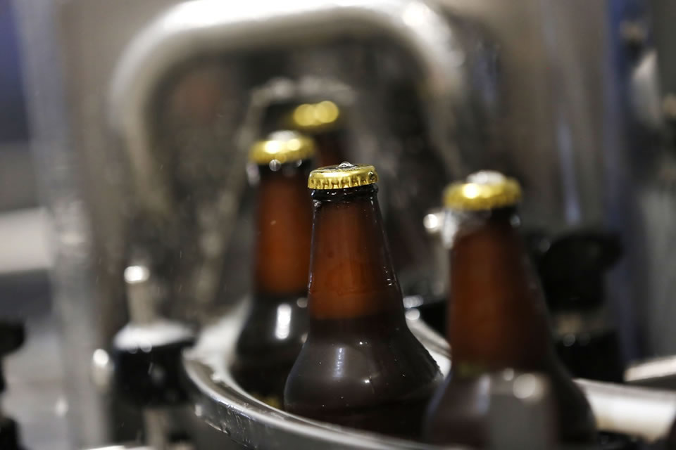 Beers being bottled at a manufacturing plant