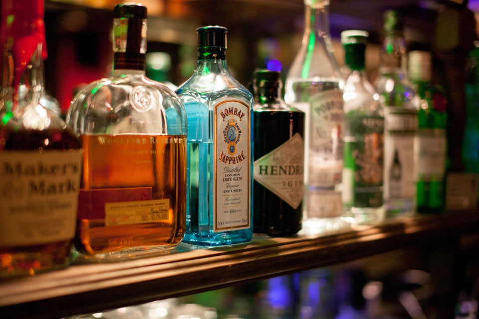 Top shelf liquors and spirits lined up for display